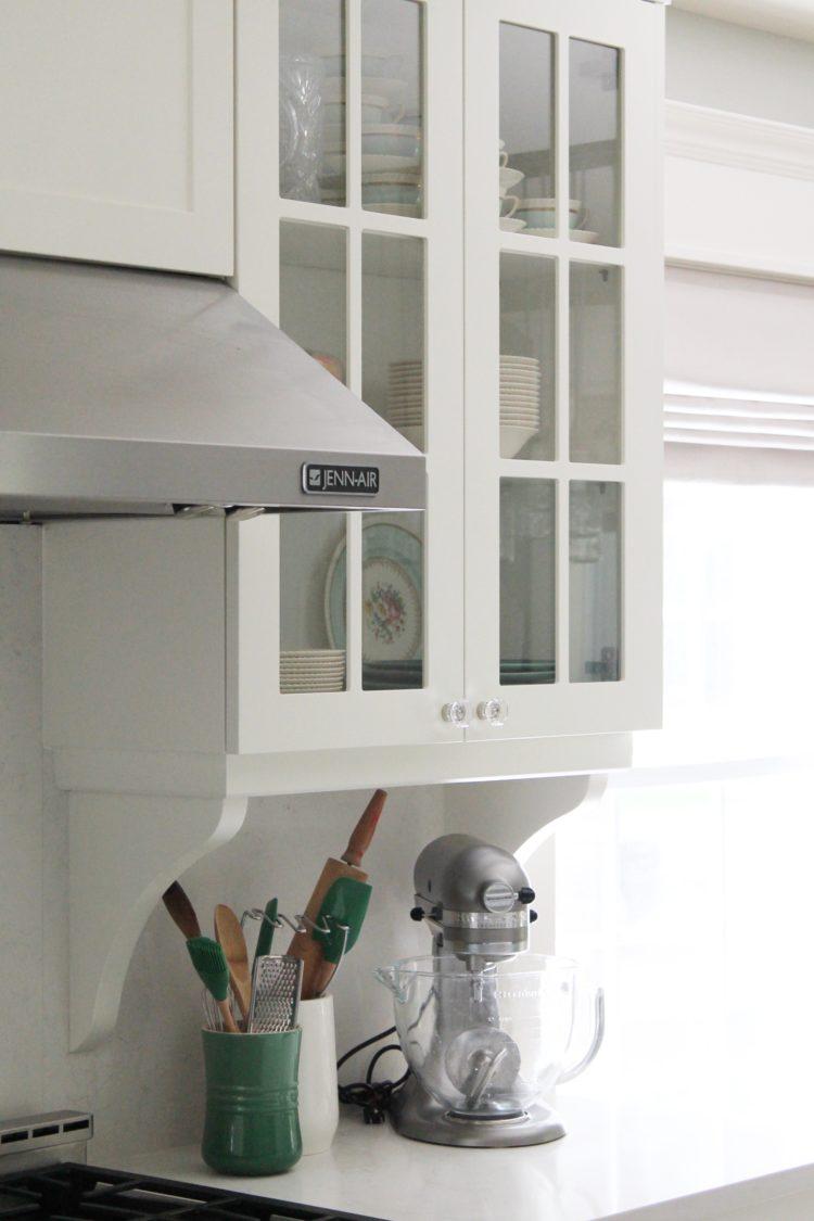 white_farmhouse_kitchen_glass_cabinet_kitchen_aid_mixer