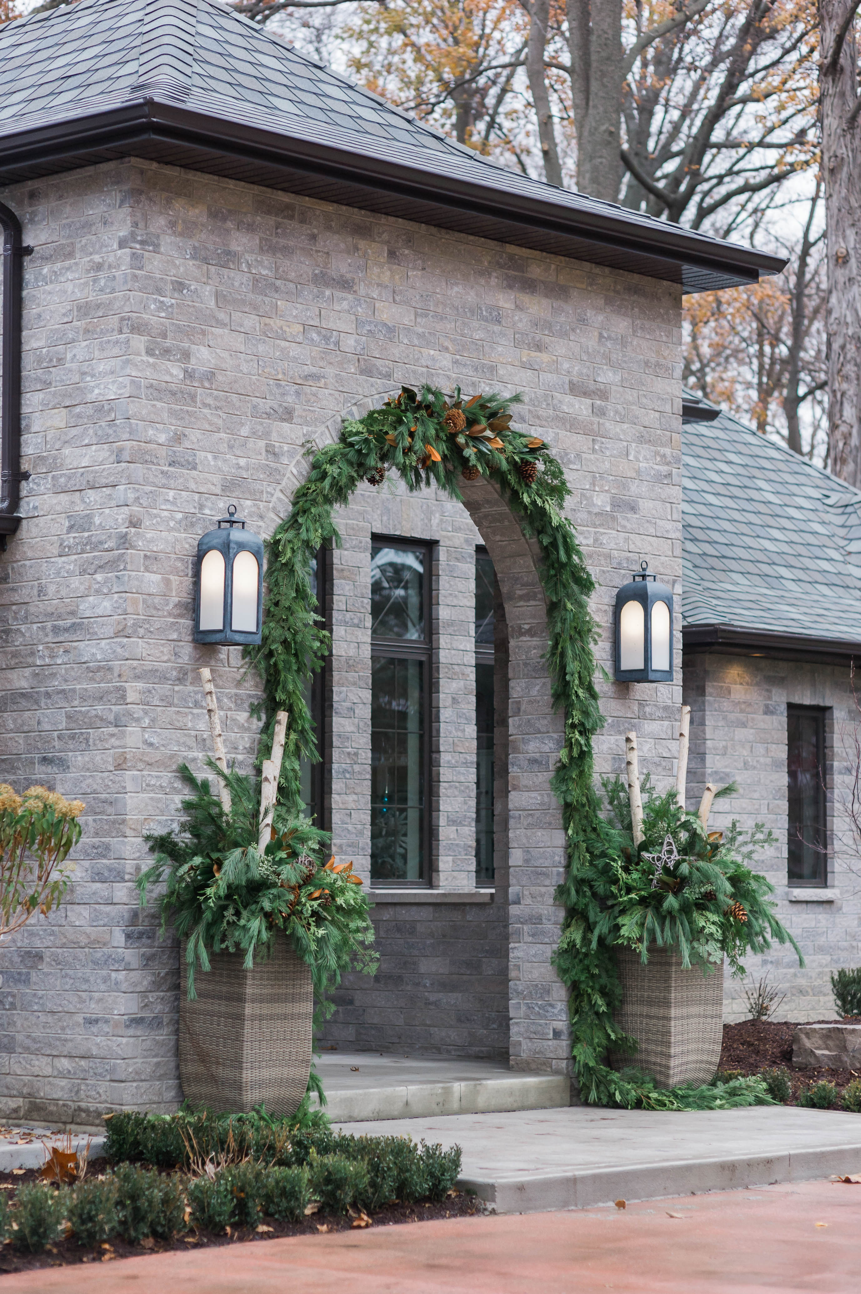 arched_door_restoration_hardware_lanterns_garland_pots_french_country