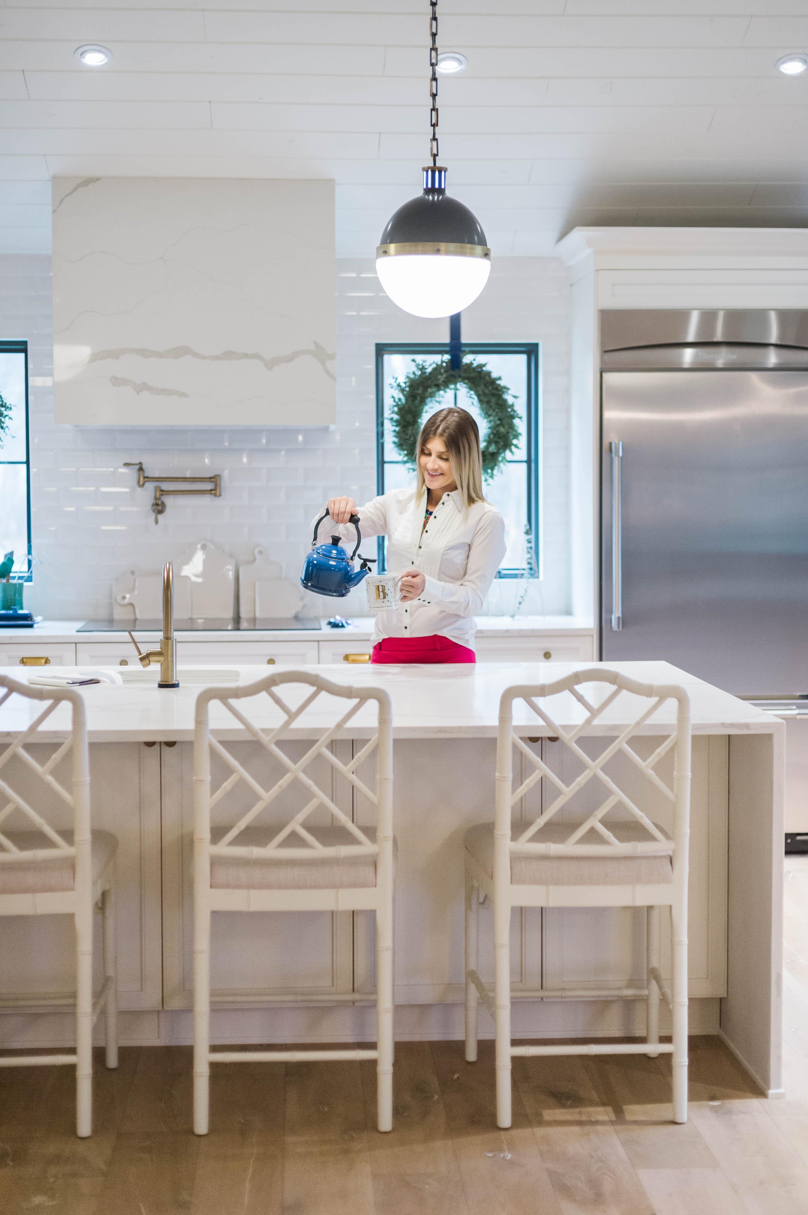 ballard_designs_dayna_stools_delta_faucet_white_kitchen