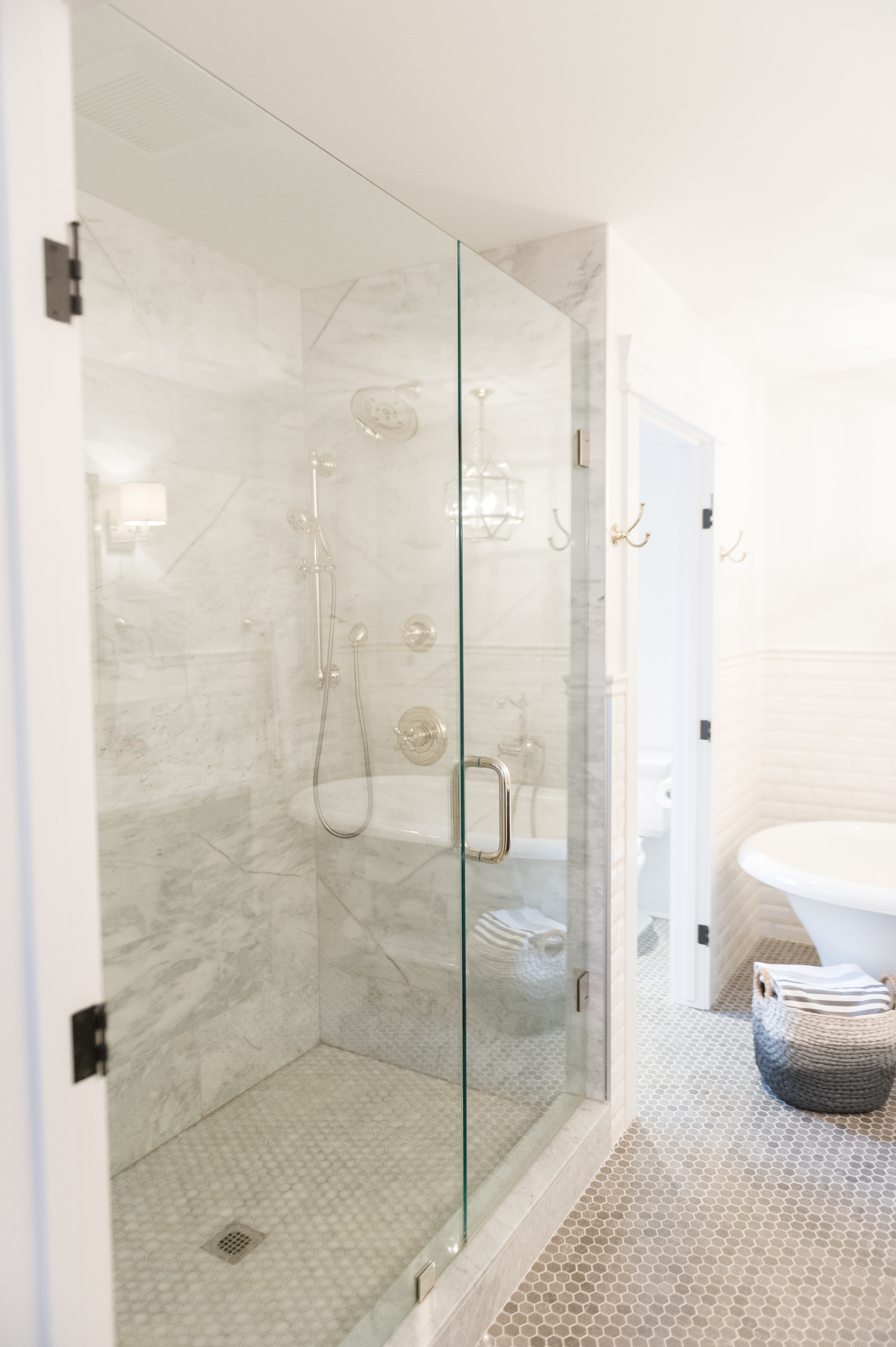 Modern french country ensuite renovation reveal the leslie style the showers have 12 x 24 marble tile the walls are a white beveled subway with a chair rail across the top doublecrazyfo Images