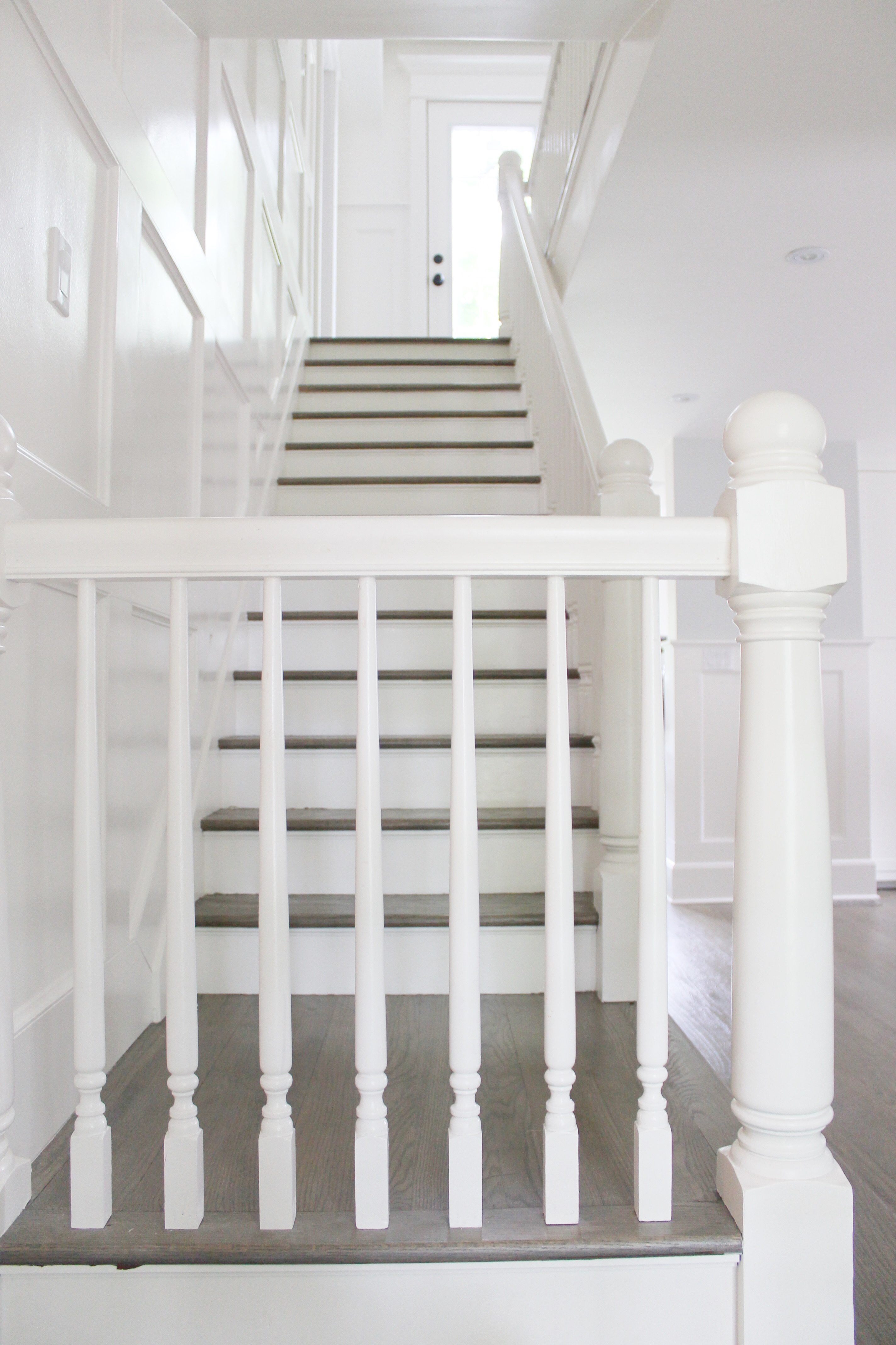 Treads In The Same Grey Stain As Floors Painting Out Posts Banister And Spindles White By Carrying Wainscoting Up Stair Wall