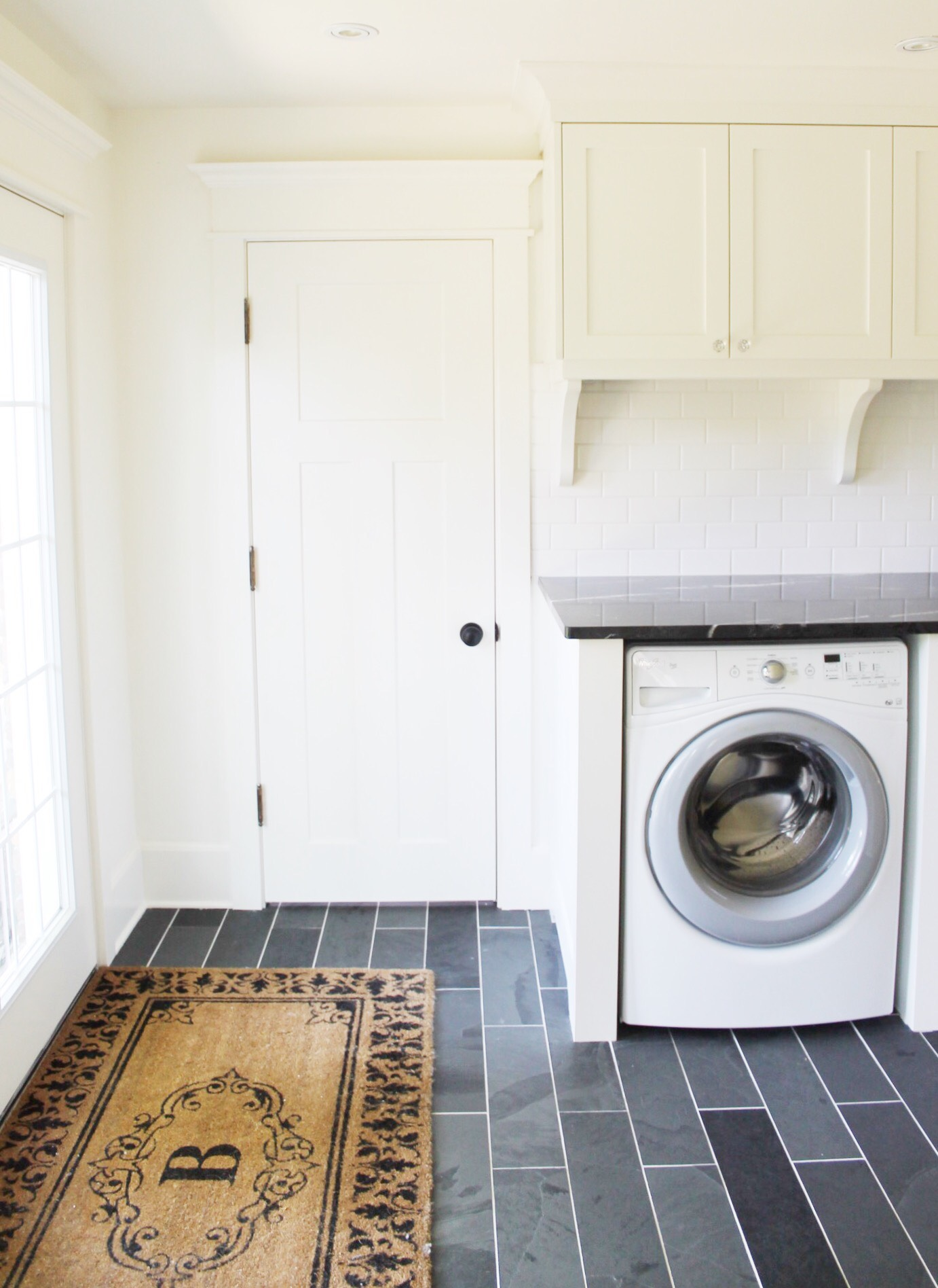 Classic Black and White Laundry Room Renovation - The Leslie Style