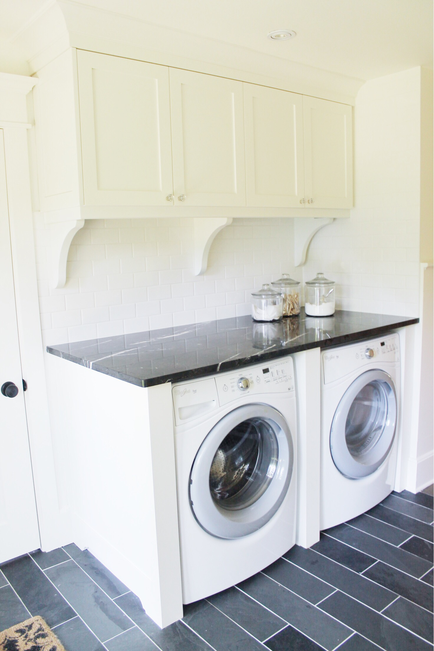 classic black and white laundry room renovation 5 - the leslie style