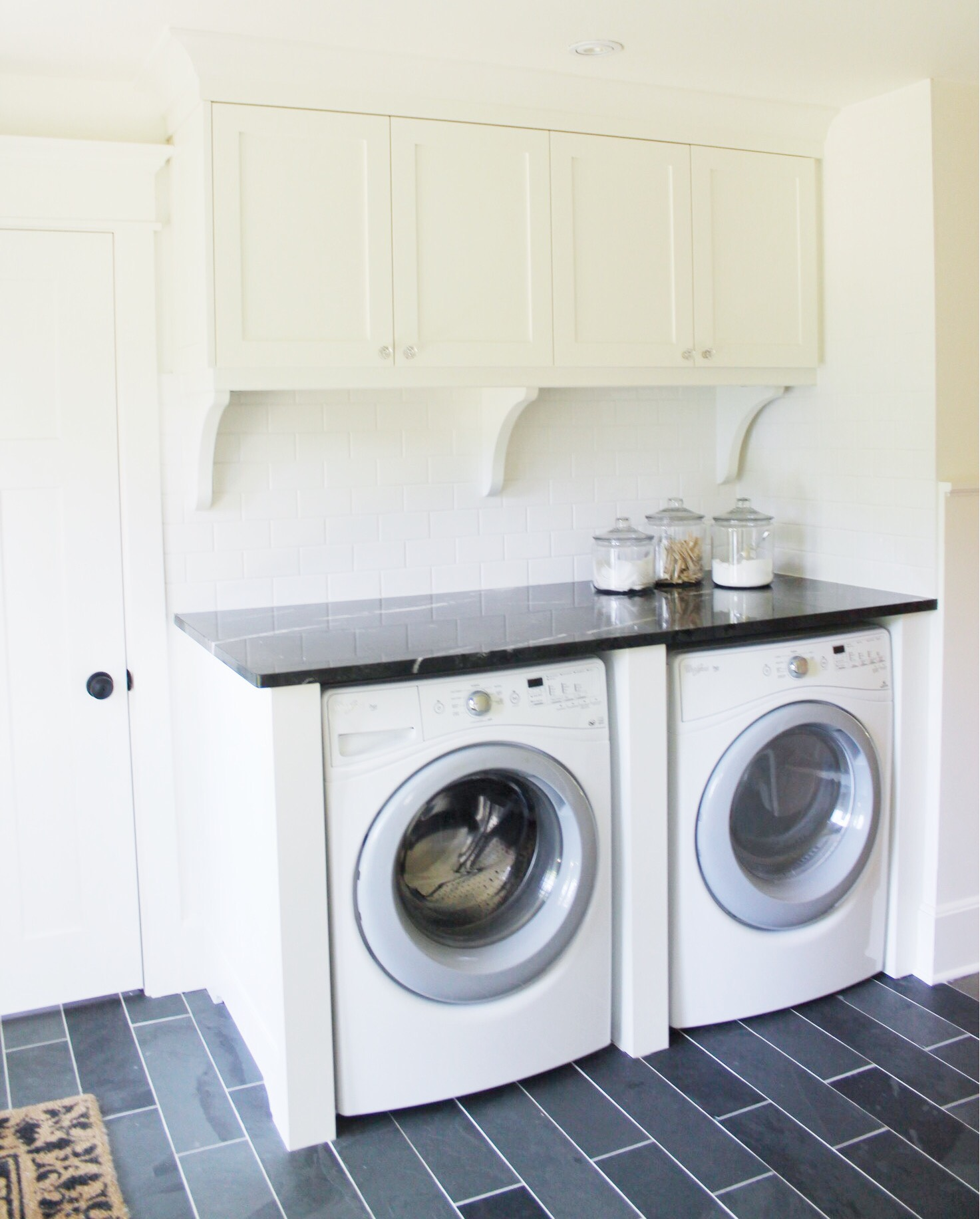 classic black and white laundry room renovation 9 - the leslie style